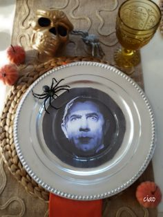 SPOOKY HALLOWEEN DINNER PARTY | Each place setting is set with a photo of one of our favorite classic spooky characters, like Dracula, Frankenstein, and the Wicked Witch of the West.