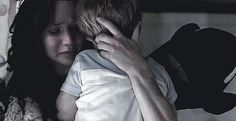 Post-Mockingjay / Katniss holding her son after having a nightmare.