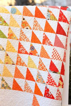 Freebird Half Square Triangles | Love the bright color against the white.