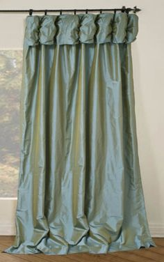 """The magic of silk provides the perfect transition from stunning window treatments to glamorous evening fashions. Discover the common """"thread"""" that links curtains to ball gowns. Enjoy a peek at some of the most beautiful examples of both!"""