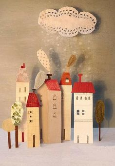This is Betania Zacarias's New Year wish for 2011. I love this little winter scene with its doily snow cloud and the lovely houses and trees with their shadows, makes me want to go and make one right now. Betania Zacarias is an Argentinian graphic designer and illustrator who now lives in the wonderful city of Barcelona.