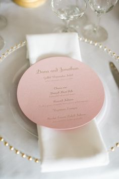 Circular pink and gold menus. Lion in the Sun. Photography: Brklyn View Photography - www.brklynview.com