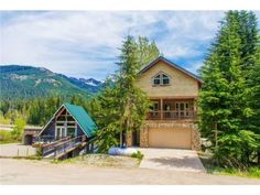 141 Kearny Dr, Snoqualmie Pass, WA 98068 | C21 Northwest Realty- Cozy Lodge style Home in a secluded Alpine setting. Enjoy the Mountain views & ski slopes. Very energy efficient built green home offers: Hickory cabinets, granite counters, slate/tile/hardwood floors, jetted tub & relaxing deck with hot tub. EF Appliances, water heater, furnace, & windows. Exterior concrete walls provide R-50 Insulation. 2 car garage. Residential or Turnkey furnished rental w/$50k income.