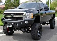 jacked up chevy trucks