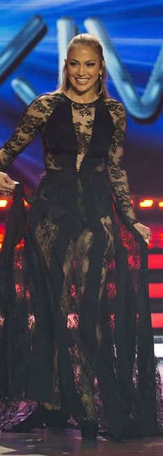 Who made Jennifer Lopez's black lace gown and platform pumps?