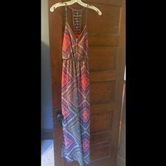 Long boho chic dress Beautiful and comfortable- perfect for day or night and an exquisite back detailing that's unique and fun! Never worn!!! Bought it without trying it on and unfortunately my body type didn't compliment it 😔 ... But looking for a good home - it's a steal ! Got it at this awesome little boutique with rare and great finds you can't find in department stores ! Barneys New York CO-OP Dresses