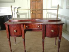 Roy Sherwood - limited edition mahogany Georgian sideboard, it has the brass rail for the curtain, The cupboards open and the drawer is lined with green felt for cutlery. sold on ebay for £67 (approx $105)
