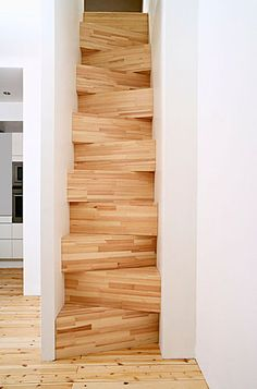 Space saving stairs made like butcherblock with strips of wood glued together. The diagonally shaped risers and treads, while arresting in appearance, would be difficult to negotiate for all but the most agile. Obviously not installed in the US since the stairs break every code in the book!