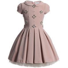 A beautiful and glamorous dusky pink dress byMonnalisa made with soft neoprene jersey that has a satin sheen and is decorated with pearls and sparkling diamante gems in the shape of flowers. It has a shaped and fitted bodice with a full skirt where the pleats are let free at the waist and fastens at the back with a hidden zip. The dress comes with an ivory, soft jersey tutu petticoat that has many layers of soft tulle netting at the hem to hold the fullness of the dress out. The dress ...