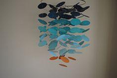 Blue/Aqua/Orange Floating Dot Mobile // Nursery Mobile by LittleDropsOfSun on Etsy https://www.etsy.com/listing/166889803/blueaquaorange-floating-dot-mobile