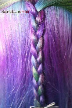 Purple hair with blue, green and yellow.  #purplehair #greenhair #yellowhair #bluehair  http://www.hartlinehair.com