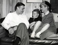 """Little Ellen Powell, daughter of Joan and Dick Powell, as she visits her mother and Clark Gable in his dressing room during the filming of """"Adventure"""" ( 1945 )."""