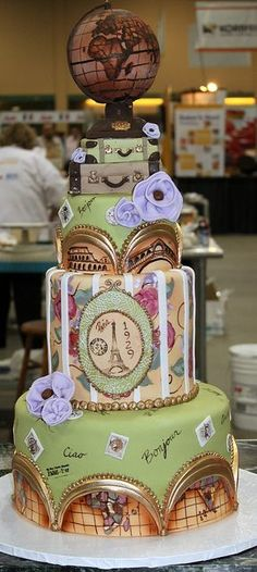 Dream cake! World travel cake. i love the globe they used. Would prefer the blue and red colors, but the idea is beautiful