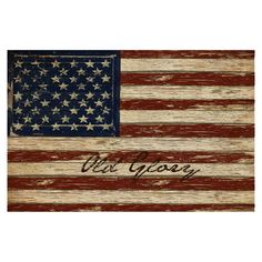 Perfect as an eye-catching focal point or in a country-chic vignette, this lovely canvas print showcases a rustic American flag motif.