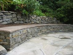flagstone patio seat wall with ledge stone rubble wall in landscape design Wall Bench, Patio Wall, Wall Seating, Patio Seating, Landscape Walls, Landscape Design, Tiered Landscape, Stone Retaining Wall, Retaining Walls