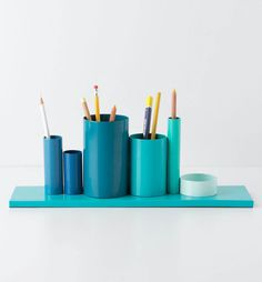 Pencils holder by anthropologie, apparently out of stock: paint wooden board, paint cans, attach