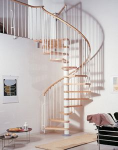Klan Spiral Staircase in White with Light Beech Treads and Balustrade on Gallery Edge. A kit staircase delivered direct to you in UK within days. See more at http://www.staircasekits.co.uk/acatalog/Spiral_Staircase_Kits.html