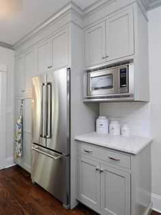 Kitchen Studio of Glen Ellyn: Gray kitchen with floor to ceiling gray kitchen cabinets painted Benjamin Moore ...