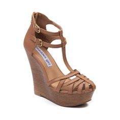 Shop for Womens Madden Girl Cage Wedge in Nude at Journeys Shoes. Shop today for the hottest brands in mens shoes and womens shoes at Journeys.com.Cage some first class cuteness and with this stunning t-strap wedge from Madden Girl! The Cage Wedge features a strappy faux leather upper, birdcage toe, dual buckle ankle strap fastener, and rear heel zipper for easy on-and-off access. 5 stacked wedge heel, 1.5 platform.