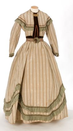 1850-1860 beige dress with moss green trimming.
