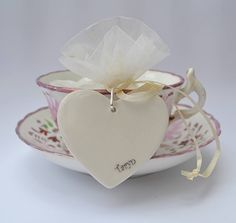 Your wedding guests will be delighted when they see their names on these handmade porcelain hearts. A wedding favour and place name setting in one. £5.00