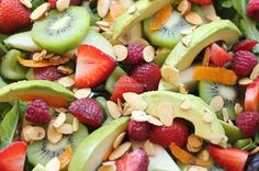 Spring Salad... lettuce, spinach, raspberries, strawberries, oranges, kiwis, pears, avocados, celery and toasted almonds... YUM! #food