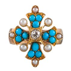 Victorian English Turquoise, Pearl and Diamond Ring -- Forming a shape which resembles a Maltese cross. Natural pearls and turquoise cabochons create the body and the center is anchored by an old European cut diamond. Vintage Turquoise, Coral Turquoise, Turquoise Jewelry, Turquoise Bracelet, Antique Rings, Antique Jewelry, Pearl And Diamond Ring, Pearl Ring, Art Deco Ring