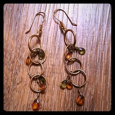 """2 pairs/$8, Earrings Gold in color with green and amber crystals. 2"""" long. All earrings are two pairs for $8. Comment and I'll bundle for you. Jewelry Earrings"""