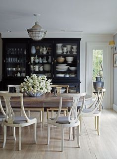 Discover the new black in interior design! - laurel home | fabulous dining room by Ruby Beets Antiques | I adore the Gustavian Swedish Antiques | bleached pale floor and all juxtaposed against the black cabinet