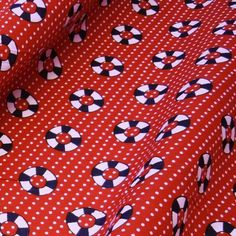 Red Polka Dot Polycotton Fabric with Nautical Life Rings (Per Metre)