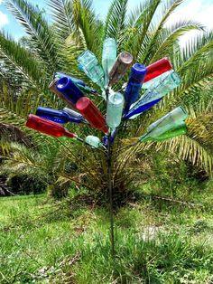 Love bottle trees! but not wine bottles, I would use all kinds of old glass soda bottles. gotta make one