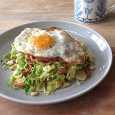 """This tasty Brussels sprout and bacon salad is currently one of my favourite meals, especially when it's topped with a crispy fried egg. What's more, this…"""