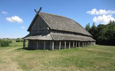 Reconstructed longhouse at Trelleborg Viking Fortress, Denmark. The fortifications encircled a total of 16 longhouses arranged in four squares. The houses had a somewhat ship-like form as the long walls were bulging outwards. Each house had four entrances, two at the short ends and two in the long walls, and was divided into three rooms with a large central hall (18 x 8 m) and two smaller rooms at the ends.