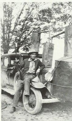 Federal Agent J.Logan Molloy who searched for moonshiners in the hills and thickets and back woods of Tenn. for 21yrs.1920 and 1930s in the photo here he has still tied to his car.photo from John Sevier