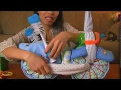 How to Make A Motorcycle Diaper Cake for Boys Video- use a book as the base to transport. Also, seat is done differently.