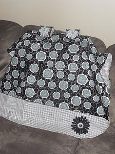 Car seat tent- don't have to use a blanket that'll fall down on baby's face.