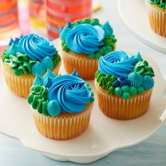Delight in the beauty of the land and sea with these bold and beautiful Happy Earth Day cupcakes. Decorated using a variety of piping techniques, including the rosette, ruffle, star and dots, these cupcakes are a tasty and fun way to celebrate the Earth's Rainbow Cupcakes, Fun Cupcakes, Wedding Cupcakes, Cupcake Cakes, Cupcake Ideas, Cupcake Piping, Green Cupcakes, Custom Cupcakes, Wedding Cake
