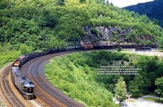 PRR Baldwin 2006 leads a westbound train around Horseshoe Curve in the Summer of Railroad Pictures, Pennsylvania Railroad, Electric Train, Train Pictures, Diesel Locomotive, Train Tracks, Trains, Transportation, Travel Destinations