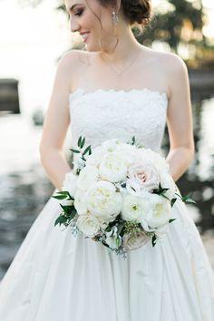 Real bride in Oscar De La Renta wedding dress from Solutions Bridal in Orlando, Florida.   Photo by Kristen Weaver Photography.