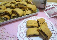 I biscotti di frolla arrotolati sono dei golosi biscottini preparati utilizzando la pasta frolla e farciti con la Nutella.