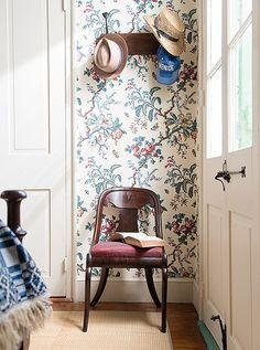 The Butterfly Chintz wallpaper produced by Adelphi Paper Hangings proves as a beautiful backdrop for this bedroom's timeless antique finds.