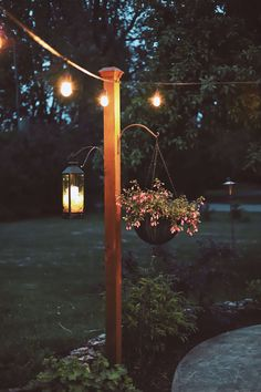 DIY Garden Posts for String Lights - Adding lights to your patio/garden area is an easy way to make your outdoor gathering space more inviting! There is nothing better than sitting outside on a summer night under the warm glow of patio lights. Patio Diy, Backyard Patio Designs, Backyard Projects, Backyard Landscaping, Patio Ideas, Diy Backyard Ideas, Patio Decorating Ideas, Backyard Decorations, Backyard Lighting