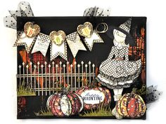 Halloween Canvas - Flying Unicorns - Scrapbook.com - Fun mixed media project using Prima doll stamps.