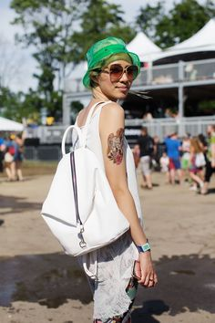 30+ Killer Festival Looks From Governors Ball #refinery29  http://www.refinery29.com/2015/06/88500/governors-ball-2015-street-style-pictures#slide-23  Could this concertgoer be cooler? Between her green bucket hat, zip-up bucket-backpack hybrid, and awesome arm ink, we can't imagine that's possible.