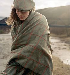 "1999 - Hackett, with an established reputation for its tweeds, launches its most enduring one in conjunction with ""Horse and Hound"" magazine, a bold and colourful tweed with a green base and red overcheck."