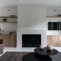 Fireplaces and fireplace mantels are fast becoming a core feature in homes across the world as they add a real feature point to any formal or indeed casual living area. Home Fireplace, Fireplace Remodel, Modern Fireplace, Living Room With Fireplace, Fireplace Design, Living Room Tv, Home And Living, Minimalist Fireplace, Minimal Home