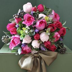 scented garden roses in shades of pink, combined with garden herbs and foliage