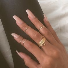 "If you're unfamiliar with nail trends and you hear the words ""coffin nails,"" what comes to mind? It's not nails with coffins drawn on them. It's long nails with a square tip, and the look has. Sns Nails, Manicure Y Pedicure, Nude Nails, Coffin Nails, Nude Sparkly Nails, Matte Gel Nails, Pink Nail, Stiletto Nails, Gorgeous Nails"