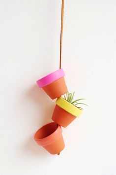 """Sunrise Super Tiny Hand Painted Terracotta Planter. Hanging 1.5"""" Mini Clay Pots. Terra Cotta Air Plant Home Decor. Made by Hoopla.. $18.00, via Etsy."""