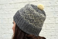 Coronal is a stranded colorwork hat with a seamless folded brim. The design is reminiscent of diamonds on a crown, or ice crystals frozen on a windowpane. A unisex design that comes in a number of sizes, the Coronal hat is perfect for three seasons (spring, fall, and winter) of wear.